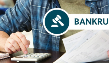 bankruptcy client using calculator